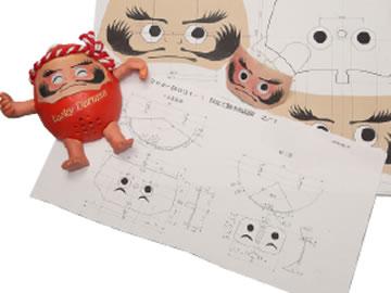 手描きのように見えるだるまの表情も 何枚もの精密な設計図から作られる